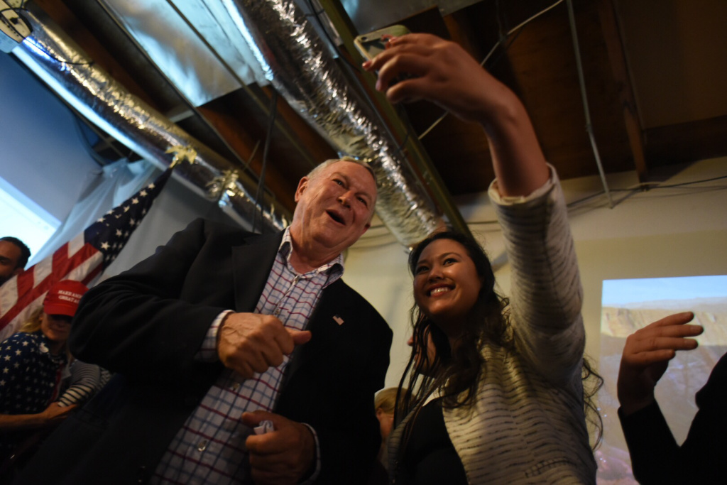 Rep. Dana Rohrabacher takes a selfie with a supporter at his election night party in Costa Mesa on Tuesday, June 5, 2018.