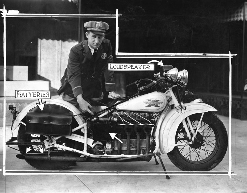 Officer L.O. Lindsay with the compact motorcycle radio equipment which he invented. Taken January 16 1932