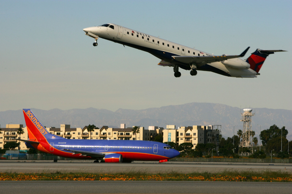 Jets land and take off on runways at Los Angels International Airport (LAX) on February 26, 2008 in Los Angeles, California.