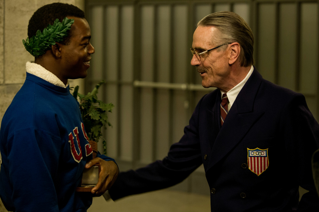 Movie still of the feature film Race, starring Stephan James (left) and Jeremy Irons (right)