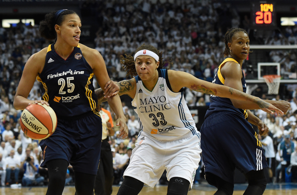 MINNEAPOLIS, MN - OCTOBER 14: Seimone Augustus #33 of the Minnesota Lynx defends against Marissa Coleman #25 of the Indiana Fever during the third quarter in Game Five of the 2015 WNBA Finals on October 14, 2015 at Target Center in Minneapolis, Minnesota. The Lynx defeated the Fever 69-52 to win the WNBA Championship. NOTE TO USER: User expressly acknowledges and agrees that, by downloading and or using this Photograph, user is consenting to the terms and conditions of the Getty Images License Agreement. (Photo by Hannah Foslien/Getty Images)
