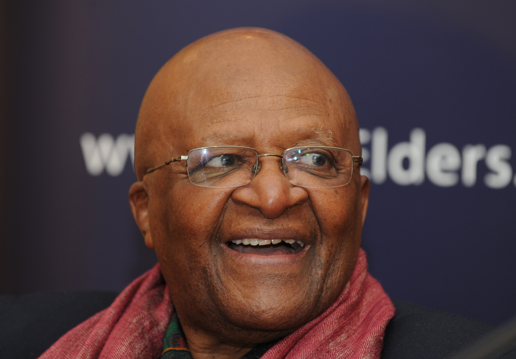 Chairman of the Elders archbishop Desmond Tutu, gestures during a joint press conference with other members of the Elders in New Delhi on February 9, 2012. The visit was part of the Elders' work to promote equality for girls and women worldwide.
