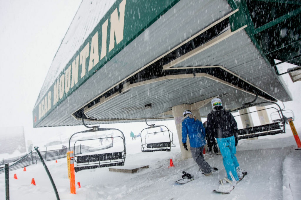 Skiers and snowboarders take to the slopes at Bear Mountain Lodge.