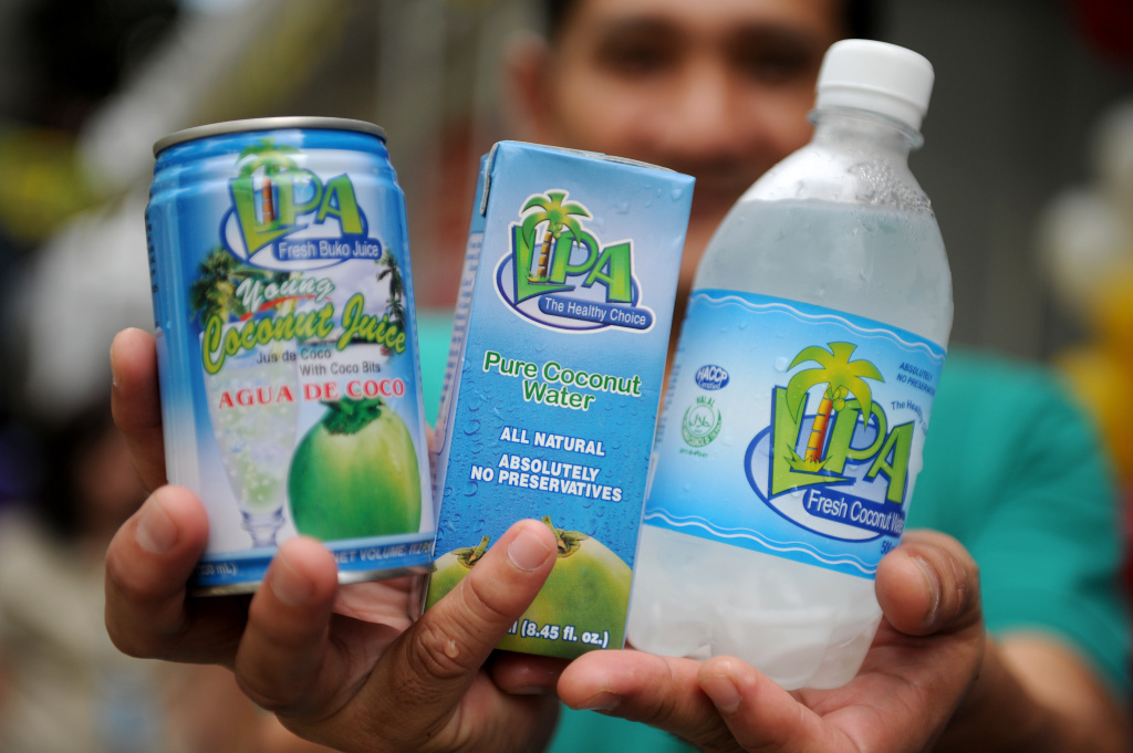 This photo taken on August 30, 2012 shows a vendor displaying coconut water products during the 26th National Coconut Week Celebration at the Philippine Coconut Authority building in Manila.