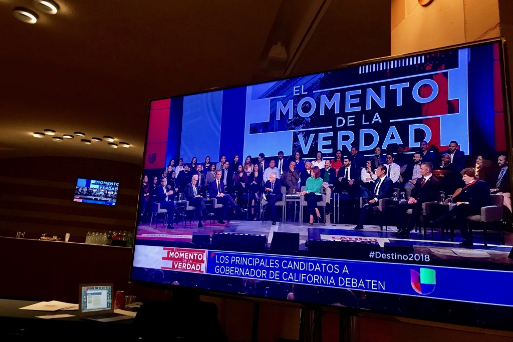 A TV screen shows the gubernatorial debate at UCLA on Jan. 25, 2018 televised by Univision.