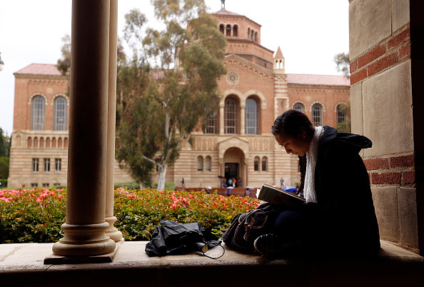 In this file photo, senior Jenna Tokeshi studies at the UCLA campus on May 14, 2015. The UC system announced Thursday, July 2, 2015, that it has accepted a total of 92,324 freshmen for the fall, 67 percent of whom are California residents. That's a drop compared to last year in the number of students from California high schools.