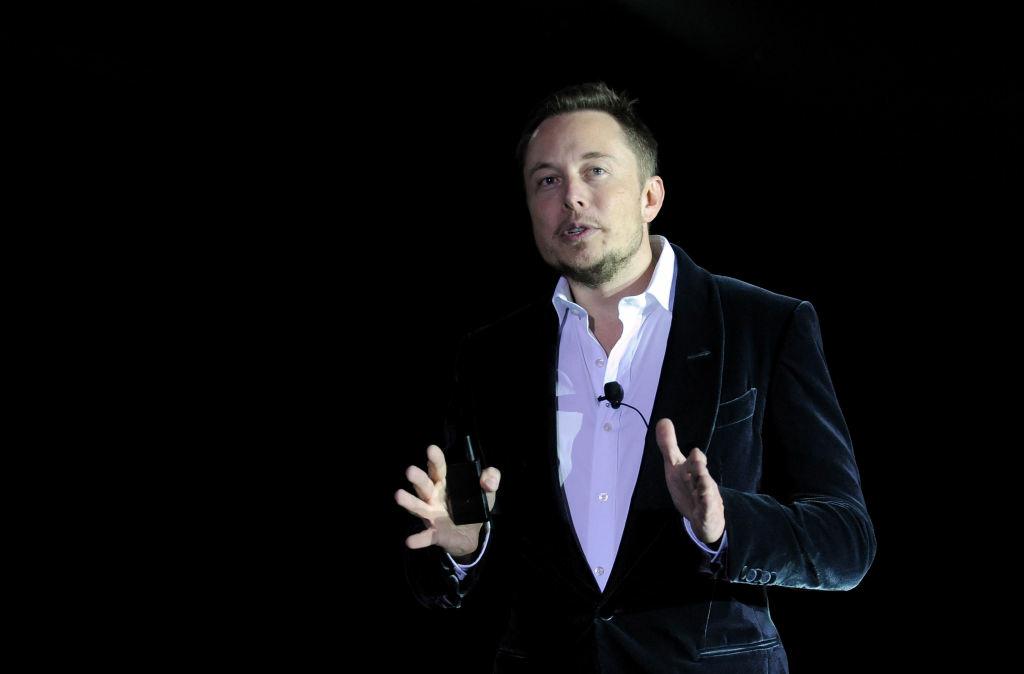 SpaceX and Tesla Motors CEO Elon Musk speaks onstage during the debut of the Model X electric vehicle in Los Angeles. Steve Jobs had the black turtleneck. Musk has the black velvet dinner jacket.
