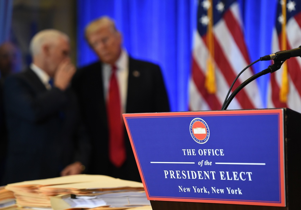 Vice President-elect Mike Pence and President-elect Donald Trump talk during Trump's press conference at Trump Tower in New York on January 11.