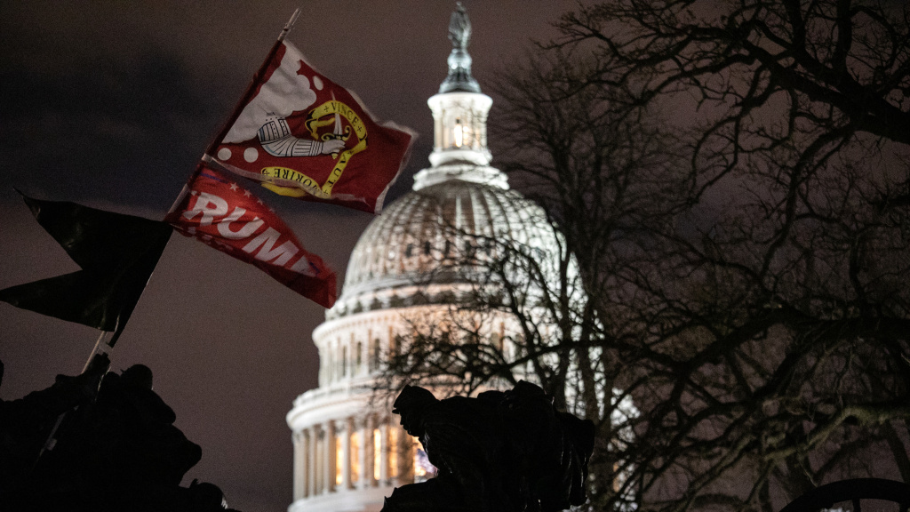A Trump flag flies over the grounds of the U.S. Capitol on Wednesday, after a pro-Trump mob stormed the building, breaking windows and clashing with police officers.