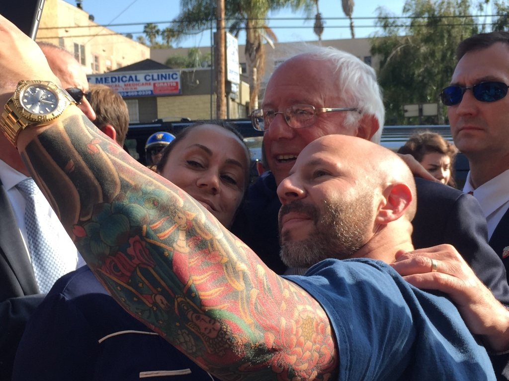 Fans pose with presidential candidate Bernie Sanders on Tuesday in L.A.'s Silver Lake neighborhood.