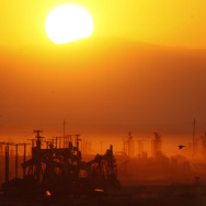 The sun rises over an oil field over the Monterey Shale formation where gas and oil extraction using hydraulic fracturing, or fracking, is on the verge of a boom near Lost Hills, California.