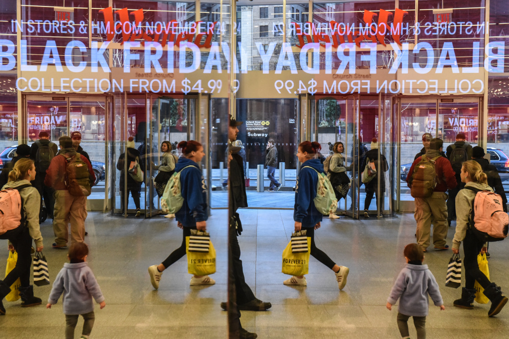 People shop at a H&M store on Black Friday on November 24, 2017 in New York City.