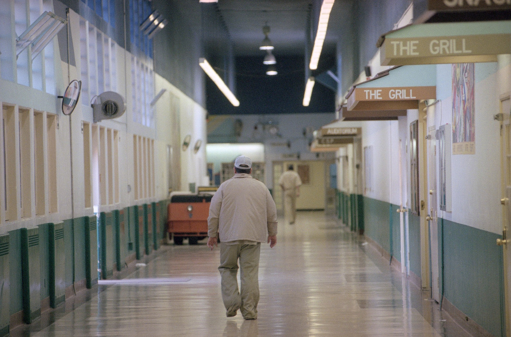 A patient walking through the halls of a psychiatric hospital in California.
