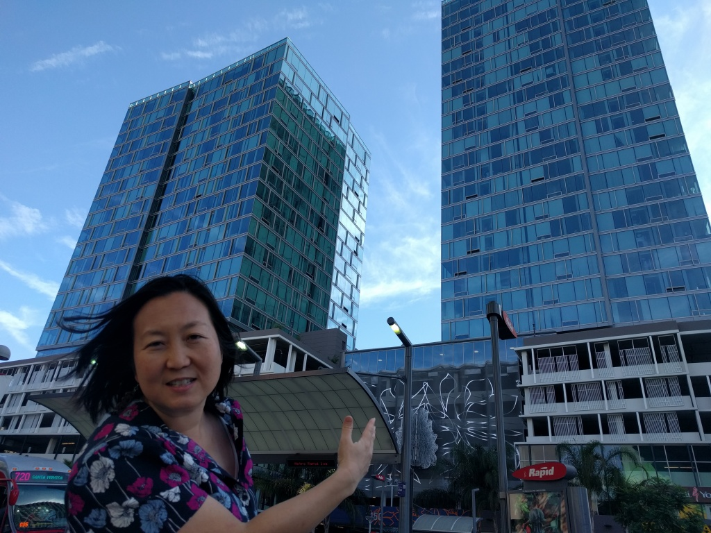 Alexandra Suh of the Koreatown Immigrant Workers Alliance points out The Vermont, an all-luxury apartment building in Koreatown.