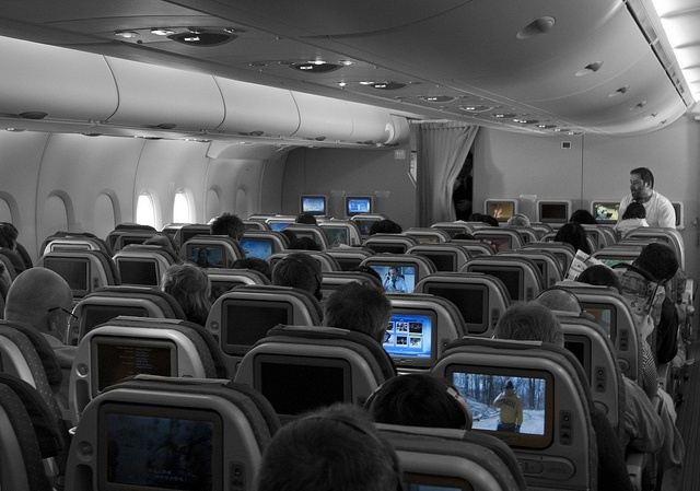 Passengers watch their television during flight