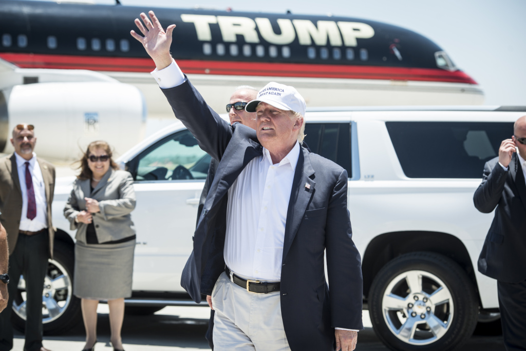 Republican Presidential candidate and business mogul Donald Trump exits his plane during his trip to the border on July 23, 2015 in Laredo, Texas.