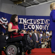Democratic presidential candidate Hillary Clinton, accompanied by Anastasia Somoza, speaks during a campaign stop at the Frontline Outreach Center in Orlando, Fla., Wednesday, Sept. 21, 2016. (AP Photo/Matt Rourke)