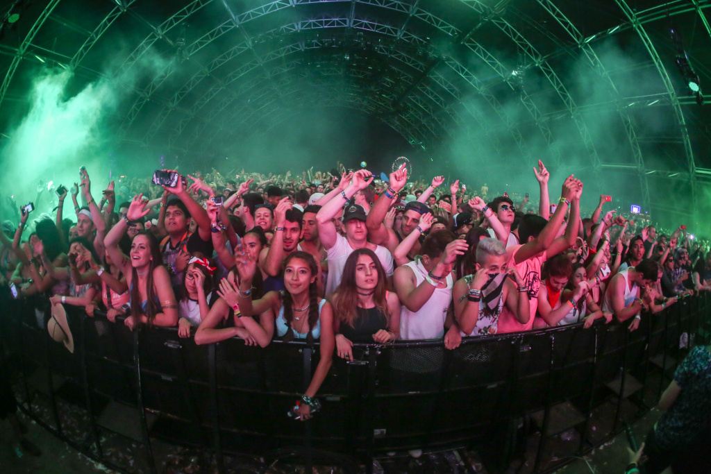 Festival goers enjoy the music in the Sahara Tent during David Guetta at the 2015 Coachella Music and Arts Festival.