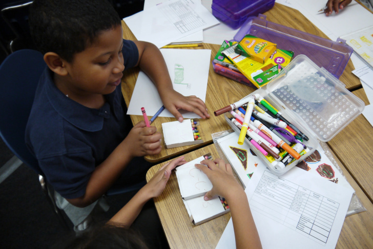 Third grade student Eder counts the amount he'll need to purchase art supplies to create a sculpture. The project is part of a grant funded endeavor that places teaching artists from the Pasadena Armory Center for the Arts with classroom teachers to help them teach integrated arts lessons.