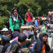 Central American migrants bound for the United States ride atop a freight train in Mexico. Mental health providers and school officials say it's important to reach recently-arrived child migrants from Central America, many of whom witnessed violence back home and along the way to the U.S.