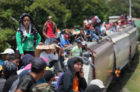 U.S.-bound Central American immigrants ride north on top of a freight train on August 6, 2013 near Juchitan, Mexico. A new academic study suggests that where immigrants come from plays a role in public anxiety over immigration.