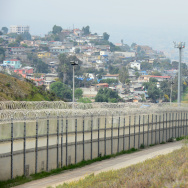 A fence runs along the U.S.-Mexico border between the Otay Mesa and San Ysidro ports of entry in and near San Diego, across from Tijuana. A House committee is set to begin marking up a new border bill this week that, among other things, would authorize 27 new miles of border fence.