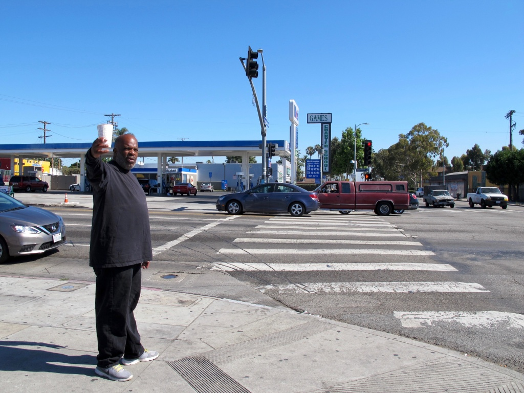 South Los Angeles resident James Harris stands at the intersection of Manchester and Western avenues, two of the most dangerous corridors in the city, according to L.A. Department of Transportation data. He hopes Vision Zero projects will make his neighborhood streets safer.