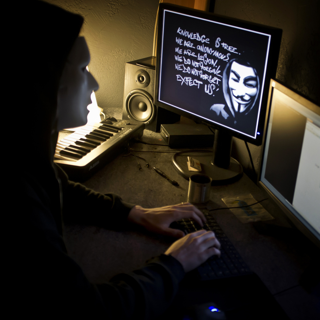 A masked hacker, part of the Anonymous group, hacked the French presidential Elysee Palace website on January 20, 2012. Anonymous, which briefly knocked the FBI and Justice Department websites offline in retaliation for the US shutdown of file-sharing site Megaupload, is a shadowy group of international hackers with no central hierarchy.