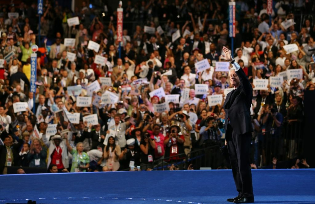 Former U.S. President Bill Clinton waves on stage during day two of the Democratic National Convention at Time Warner Cable Arena on September 5, 2012 in Charlotte, North Carolina.