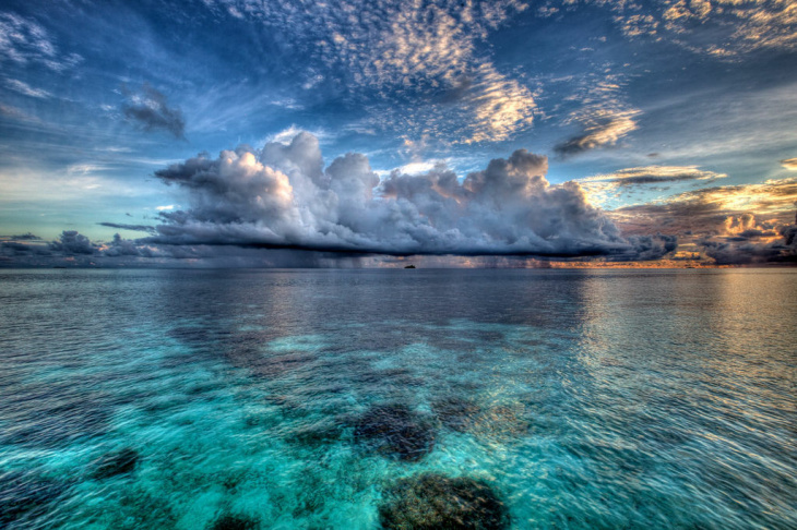 The 200-island nation of the Maldives exists mostly within a meter of sea level. As seas rise, it's threatened, but changing temperature and ocean acidification are problems for seafood-eating residents, too.