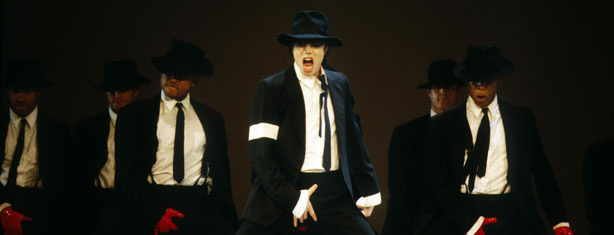 Michael Jackson performing onstage at the 1995 MTV Video Music Awards.