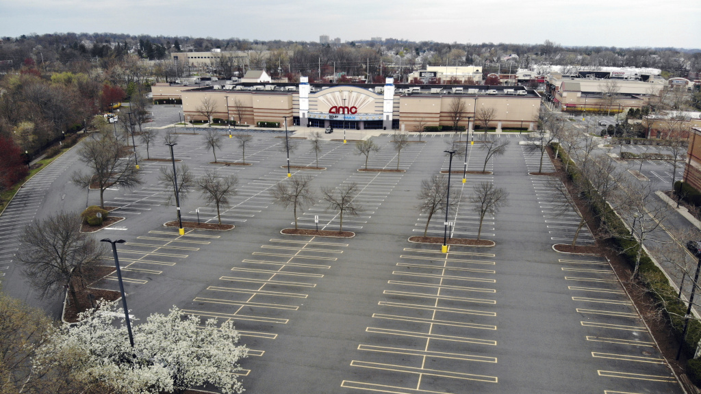 Movie chains are suing to be included in New Jersey's reopening plans. An empty parking lot is seen at an AMC movie theater in Clifton, N.J, on April 5.