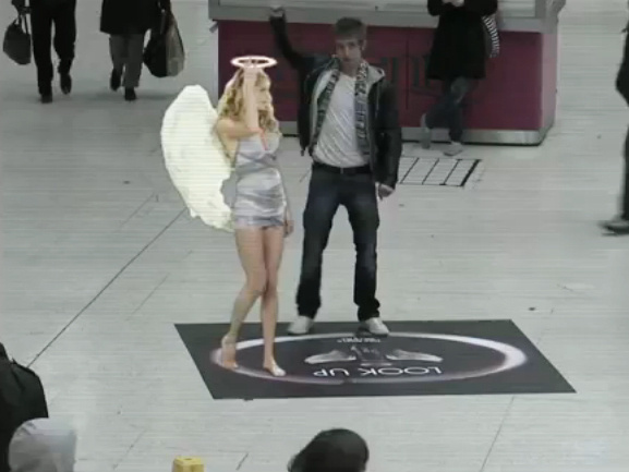 The Lynx angel appears in London's Victoria Station.