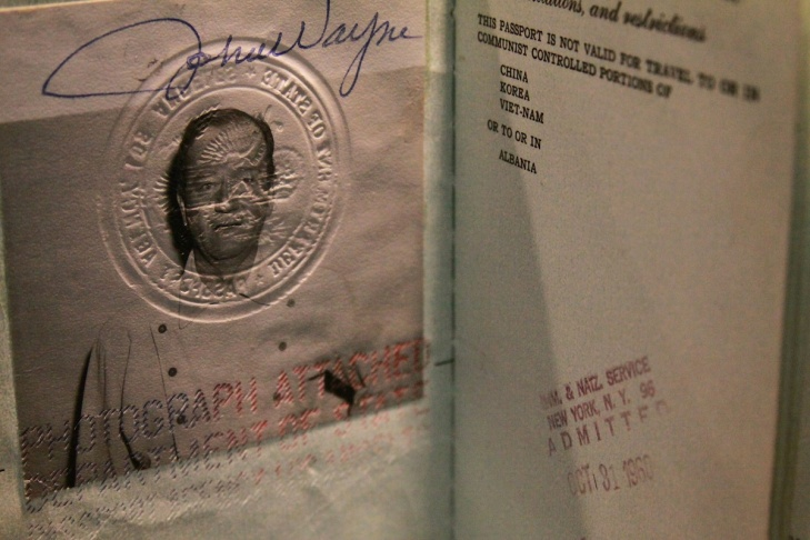 John Wayne's passport was among the items to be auctioned off today. The auction is expected to rake in $1.5 million.