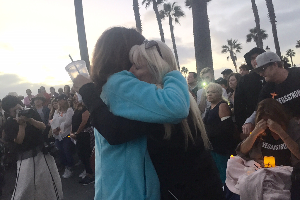 Hundreds of people joined a vigil in Huntington Beach to remember the 58 victims killed in a shooting in Las Vegas. The vigil was held Sunday, October 8th 2017. (Libby Denkmann/KPCC)