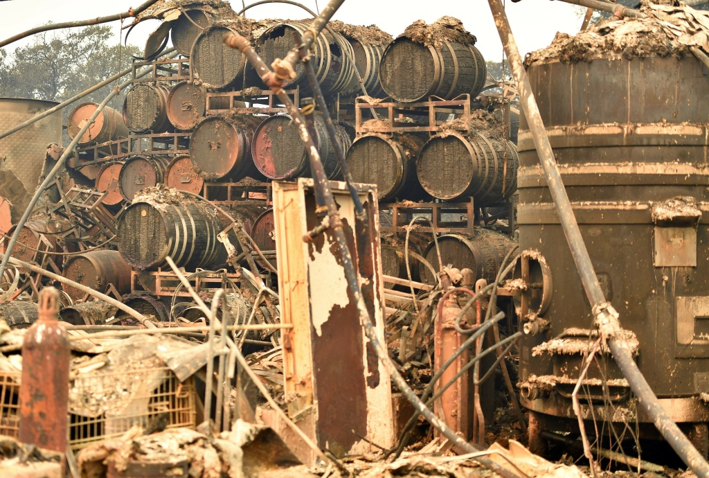 Burned wine barrels are seen at the destroyed Paradise Ridge Winery in Santa Rosa, California on October 10, 2017.