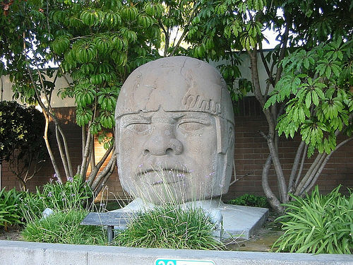 Covina's giant Olmec head once graced the city police station but now sits in a maintenance yard.