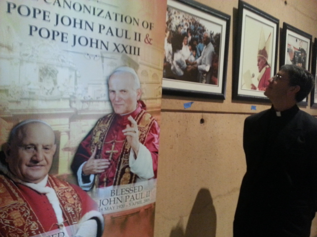 Father Ed Beniof Director of New Evangelization at L.A. Archdiocese looks at a new exhibit at the Cathedral of Our Lady of the Angels honoring the two Popes that will be made saints this weekend on April 27, 2014.