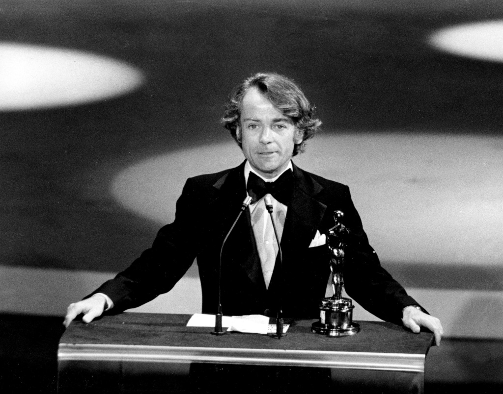 In this March 28, 1977, file photo, John G. Avildsen accepts the Oscar for best director for
