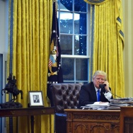 US President Donald Trump speaks on the phone with Australia's Prime Minister Malcolm Turnbull from the Oval Office of the White House on January 28, 2017, in Washington, DC.