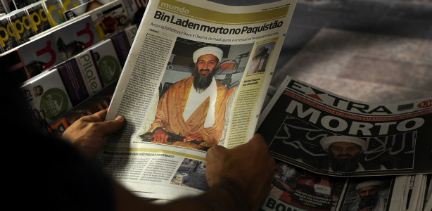 A man reads a newspaper announcing the death of Osama bin Laden, at a newsstand in Rio de Janeiro on May 2, 2011. Al-Qaeda leader Osama bin Laden was shot dead deep inside Pakistan in a night-time helicopter raid by US covert forces, ending a decade-long manhunt for the mastermind of the September 11 attacks.