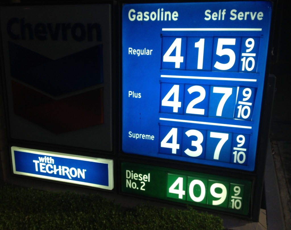 The Labor Department reported Tuesday that a jump in gasoline costs pushed a measure of U.S. consumer prices up in June. But the overall trend in inflation stayed tame. (Photo: Gasoline prices at a Newport Beach, Calif. Chevron station on July 16, 2013)