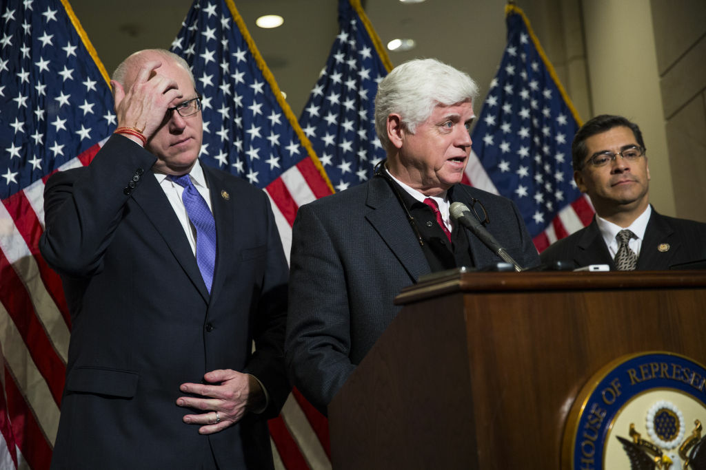(L-R) Represenatives Joseph Crowley (D-NY), John Larson (D-CT), and Xavier Becerra (D-CA) hold a news conference about jobs and the 'fiscal cliff' on Capitol Hill, December 30, 2012 in Washington, DC.