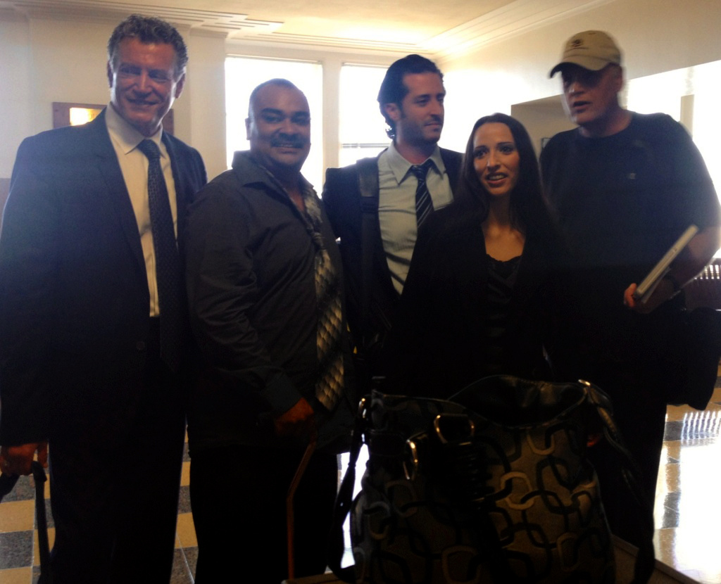 Angel Mendez (second to left) and his wife Jennifer Mendez pose for a picture with their attorneys after a court hearing that awarded them approximately $4 million for a 2010 LA Sheriff's deputy shooting in Lancaster that forced doctors to amputate Angel Mendez' leg.