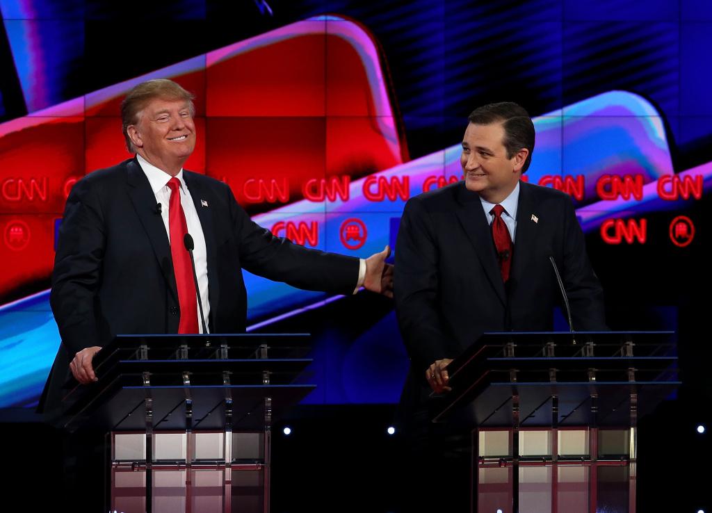 Republican presidential candidates Donald Trump (L) and Sen. Ted Cruz (R-TX), interact during the CNN republican presidential debate.