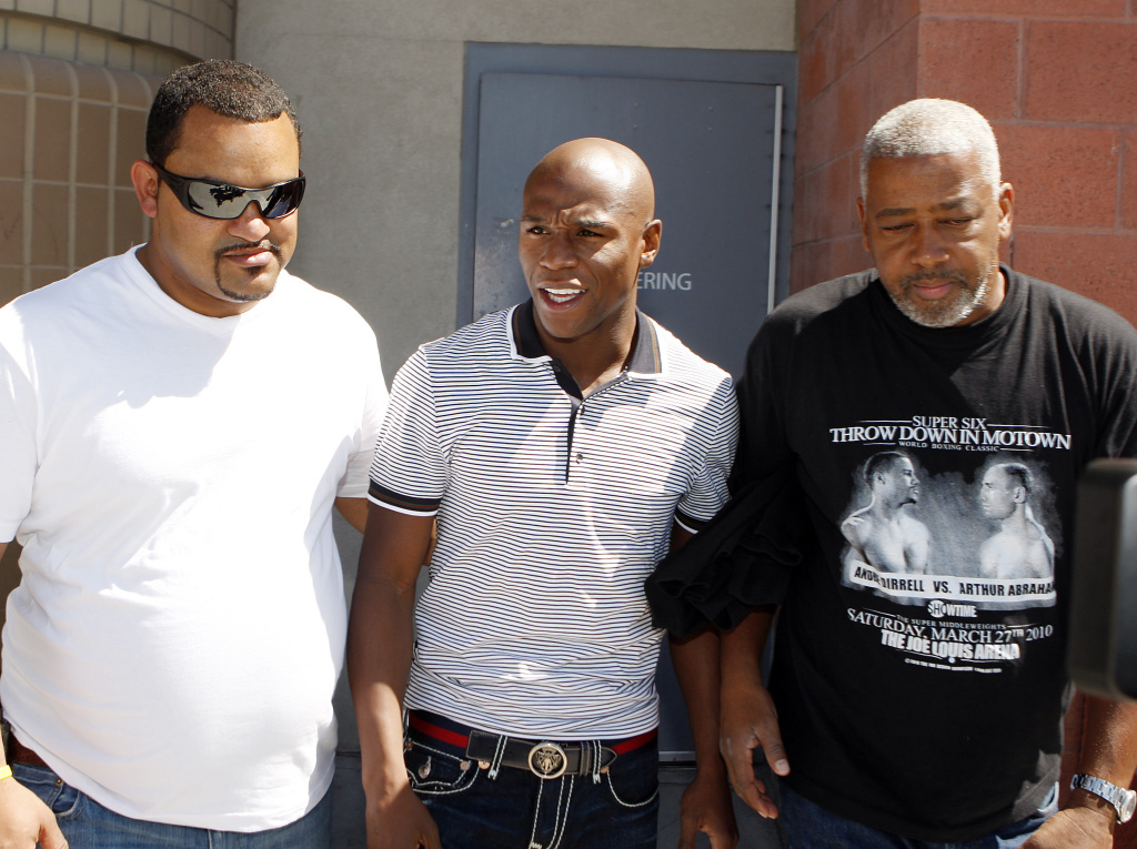 In this Sept. 10, 2010, file photo, boxer Floyd Mayweather Jr., center, escorted by unidentified friends, exits the Clark County Detention Center after posting bail on a grand larceny charge stemming from a domestic violence complaint, in Las Vegas. The mother of three of Floyd Mayweather's children has sued the undefeated champion for defamation over his recent comments about a 2010 domestic violence incident in Las Vegas. Josie Harris filed the lawsuit Tuesday, May 5, 2015,  in Los Angeles, days after Mayweather defeated Manny Pacquiao in a highly anticipated bout.