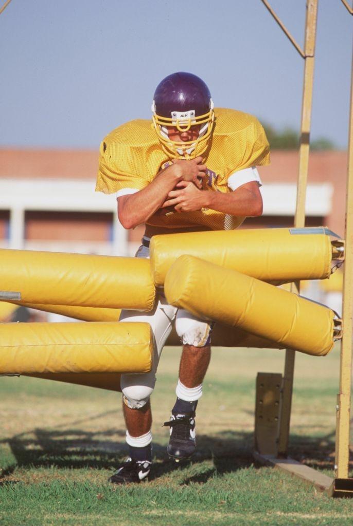 A football player from Los Angeles Baptist High School runs through a pre-season practice.