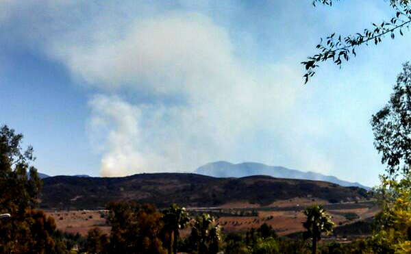 An image of the Baker Fire burning east of Santa Ana Sunday.