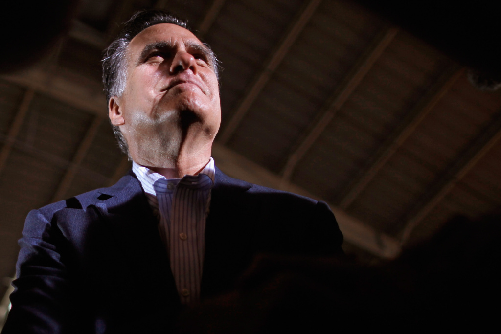 Republican presidential candidate and former Massachusetts Gov. Mitt Romney greets supporters and gives autographs after a speech at the National Gypsum Company January 24, 2012 in Tampa, Florida. Romney's speech was billed as a