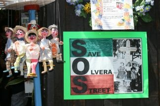"Posters saying ""Save Olvera Street"" greet visitors to the 80th anniversary celebrations of Olvera Street in downtown Los Angeles on on April 24, 2010."
